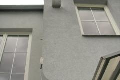 Nerezový komín na fasádě